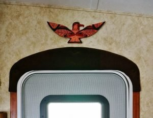 Thunderbird carving mounted above the RV door