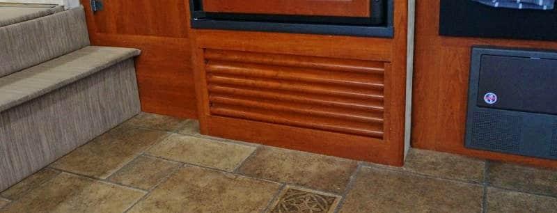 RV furnace access panel under fridge
