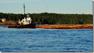 Tug Pushing Log Boom