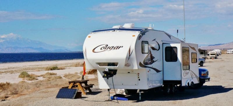 Dry camping at Corvina Beach remote solar panel deployed