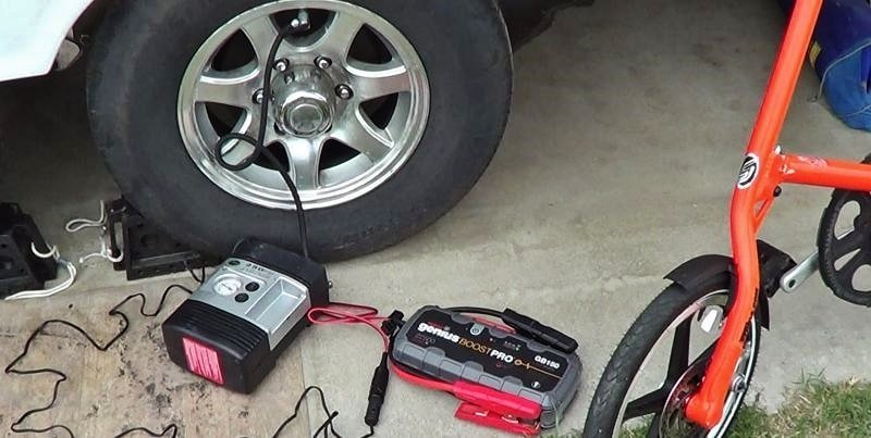 NOCO GB 150 Battery Booster Box Powering Air Compressor