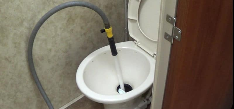 Black Tank Flushing Wand in Toilet