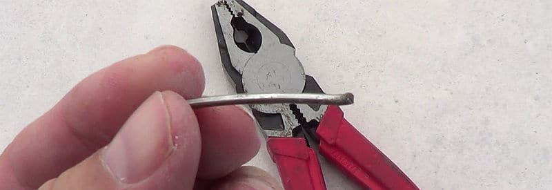 Broken staple pulled from roof